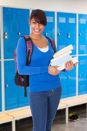 changing room: Portrait Of Female Student Holding Book In Changing Room