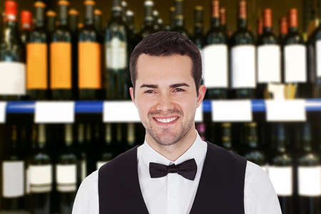 Portrait Of A Young Bartender Smiling In Bar photo