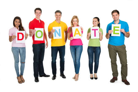 Group Of People Holding Letter Donate Over White Background photo