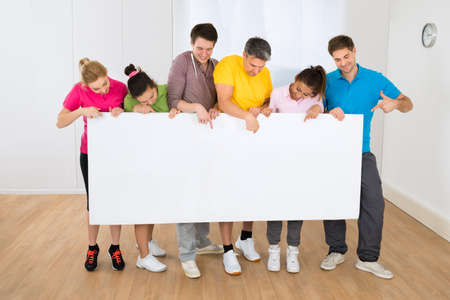 gym class: Group Of Happy Multiethnic People Holding Blank Placard