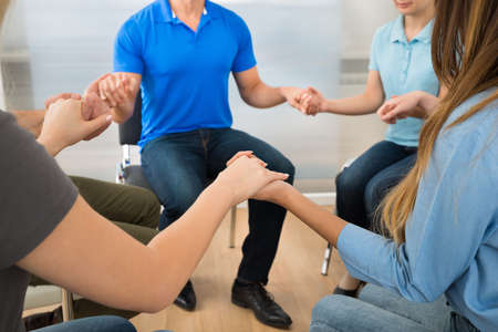 religious: Group Of People Playing Together Holding Hands