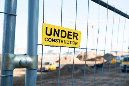 under construction: Photo Of Under Construction Sign On Gate Stock Photo