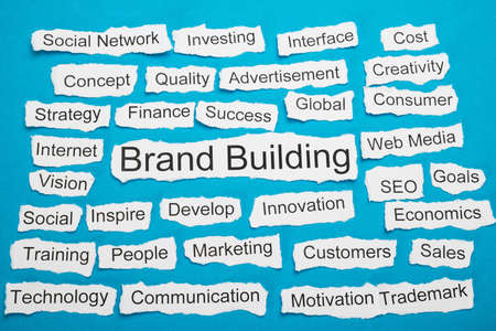 salient: Word Brand Building On Piece Of Paper Salient Among Other Related Keywords