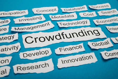 salient: Word Crowdfunding Rate On Piece Of Paper Salient Among Other Related Keywords Stock Photo