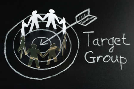 interlinked: Circle Of Target Group Over Dart And Arrow Drawn On Blackboard With Chalk Stock Photo