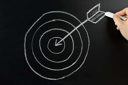 Hand Drawing Dart And Arrow With Retargeting Word On Blackboard