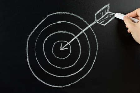 DARTS: Hand Drawing Dart And Arrow With Retargeting Word On Blackboard