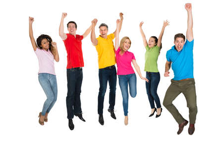 Excited Group Of Multiethnic People Jumping Over White Background