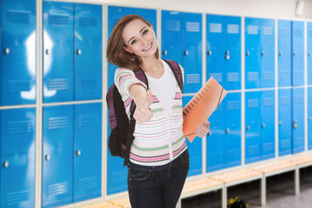 changing room: Young Female College Student In Changing Room Gesturing Thumb-up