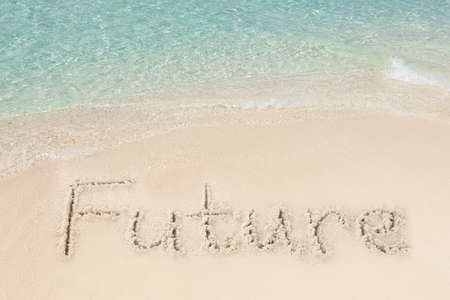 forthcoming: Future written on sand by sea at beach