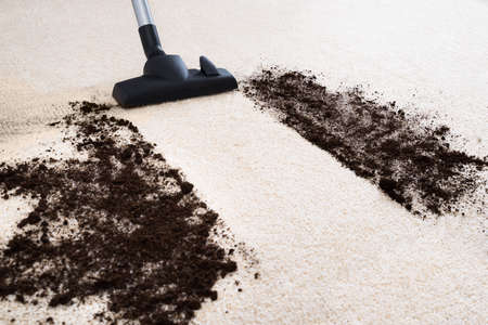 vacuum: Photo Of Vacuum Cleaner Cleaning Dirt On Carpet Stock Photo