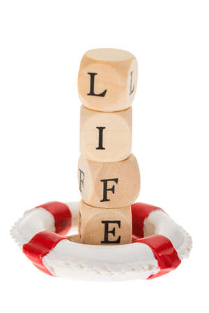 life belt: Close-up Of Life Belt Saving The Word Life On Wooden Pieces Against White Background Stock Photo