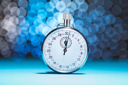 Photo Of Stopwatch On Blue Bokeh Background