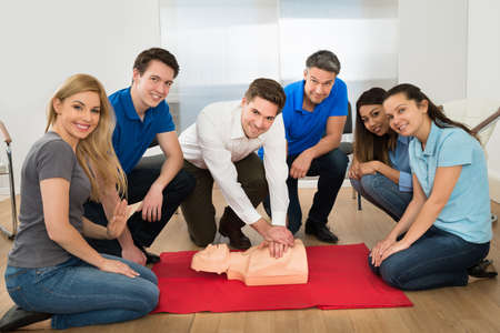 first floor: Group Of Multiethnic People In Resuscitation Training
