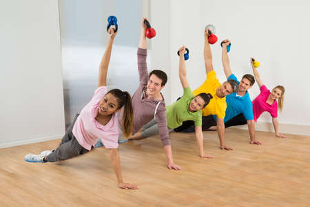 Diverse Multiethnic Group Of Fit Friends Exercising Together photo