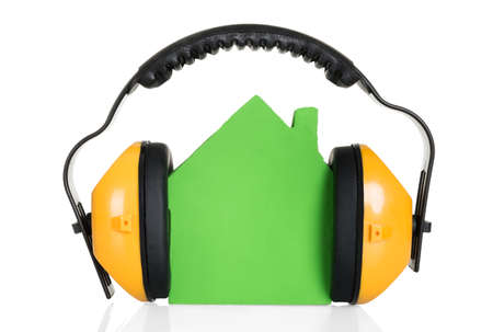 Green House Model With Headphone Over White Background