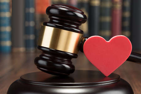 divorce court: Close-up Of Wooden Gavel And Red Heart On Table