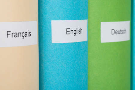 Three Different Learning Languages Books In Row photo