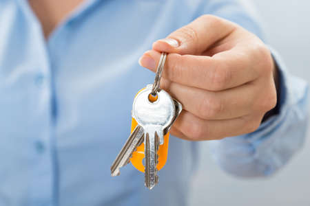 passkey: Close-up Of Businessperson Hand Holding Key In Hand
