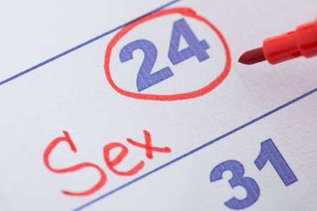 romantic sex: Close-up Of Date Marked With Red Pen For Sex On Calendar Stock Photo