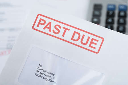 Extreme Close-up Of Past Due Bill Envelope