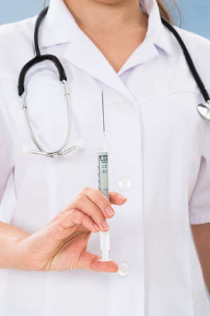 anesthesiologist: Close-up Of Female Doctor Holding Syringe In Hand