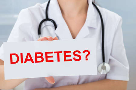 type: Close-up Of Female Doctor Holding Placard With Text Diabetes Stock Photo