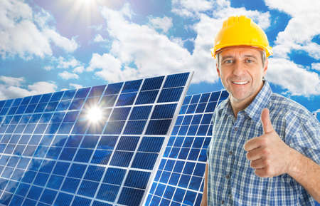 Mature Man With Photovoltaic Solar Panel Showing Thumb Up