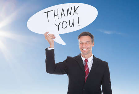 thanksgiving adult: Happy Mature Businesswoman Holding Speech Bubble With Thank You Text