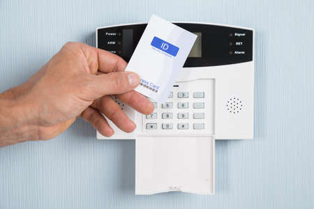 Close-up Of A Person Holding Security Card To Open Door. Photographer owns copyright for card design photo