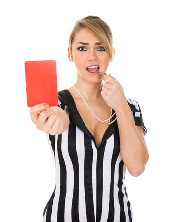 Young Female Referee Holding Red Card Over White Background photo