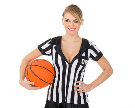 arbitrator: Female Referee With Orange Basketball In Hand Over White Background Stock Photo