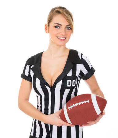 Young Beautiful Female Referee Holding American Football