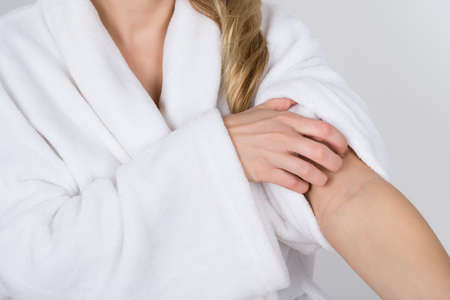 dryness: Close-up Of A Woman In Bathrobe Suffering From Itching