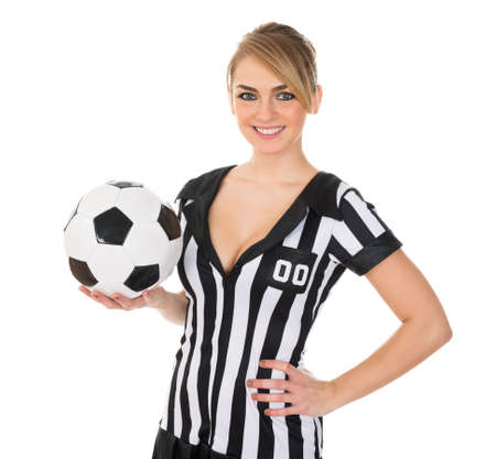arbitrator: Portrait Of Young Sexy Soccer Referee With Football Stock Photo