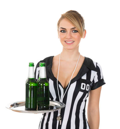 Portrait Of Beautiful Female Referee With Drinks On Tray Over White Background