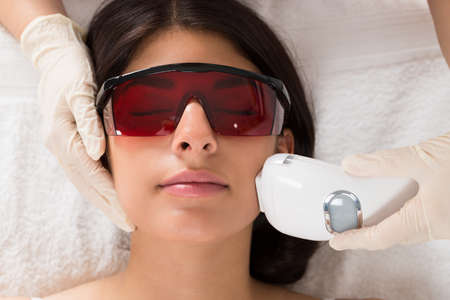 Close-up Of Beautician Giving Epilation Laser Treatment On Woman's Face Stock fotó