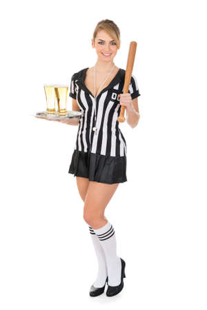 Portrait Of Happy Female Referee Holding Tray With Beer And Baseball Bat photo