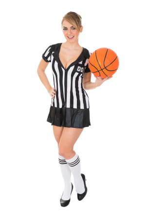 Young Attractive Female Referee Holding Basketball Over White Background