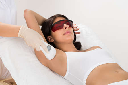 depilation: Woman Receiving Epilation Laser Treatment On Armpit At Beauty Clinic
