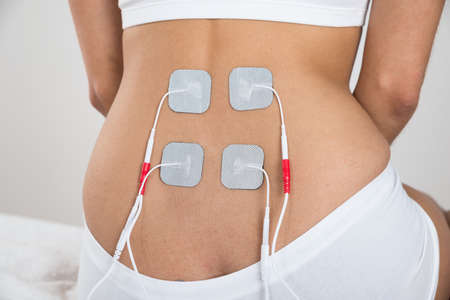 therapeutics: Close-up Of A Woman With Electrodes On Her Back