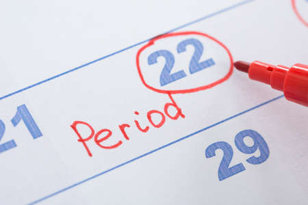 menses: Close-up Of Sketchpen With Marked Menses Date On Calendar