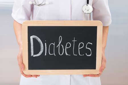 Close-up Of Doctor Showing Text Diabetes On Slate Chalkboard