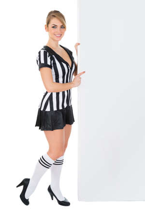 football socks: Young Female Referee With Blank Billboard Over White Background Stock Photo