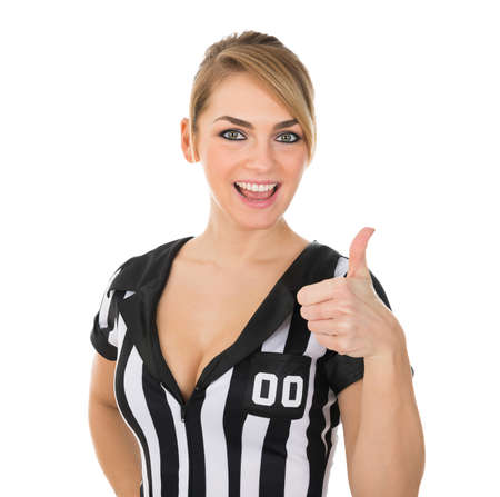 Portrait Of Happy Female Referee Showing Thumbs Up Over White Background