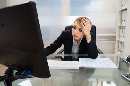 stressed business woman: Portrait Of Stressed Businesswoman Working On Computer In Office
