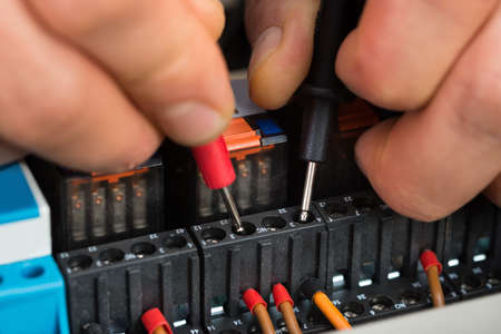39942284 close up of a male electrician checking fuse with multimeter?ver=6 close up of a electrician checking fuse box with multimeter stock how to check fuse box with multimeter at crackthecode.co