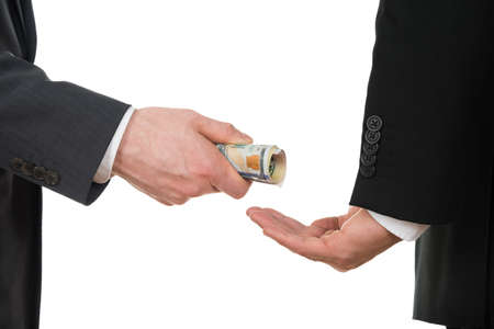 venal: Close-up Of A Businessman Taking Bribe Over White Background Stock Photo
