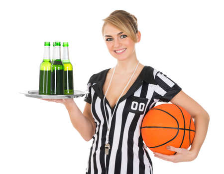 Portrait Of Female Referee With Drinks And Basketball Over White Background Stock Photo