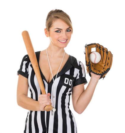 arbitrator: Young Beautiful Referee Wearing Baseball Glove And Holding Baseball Bat